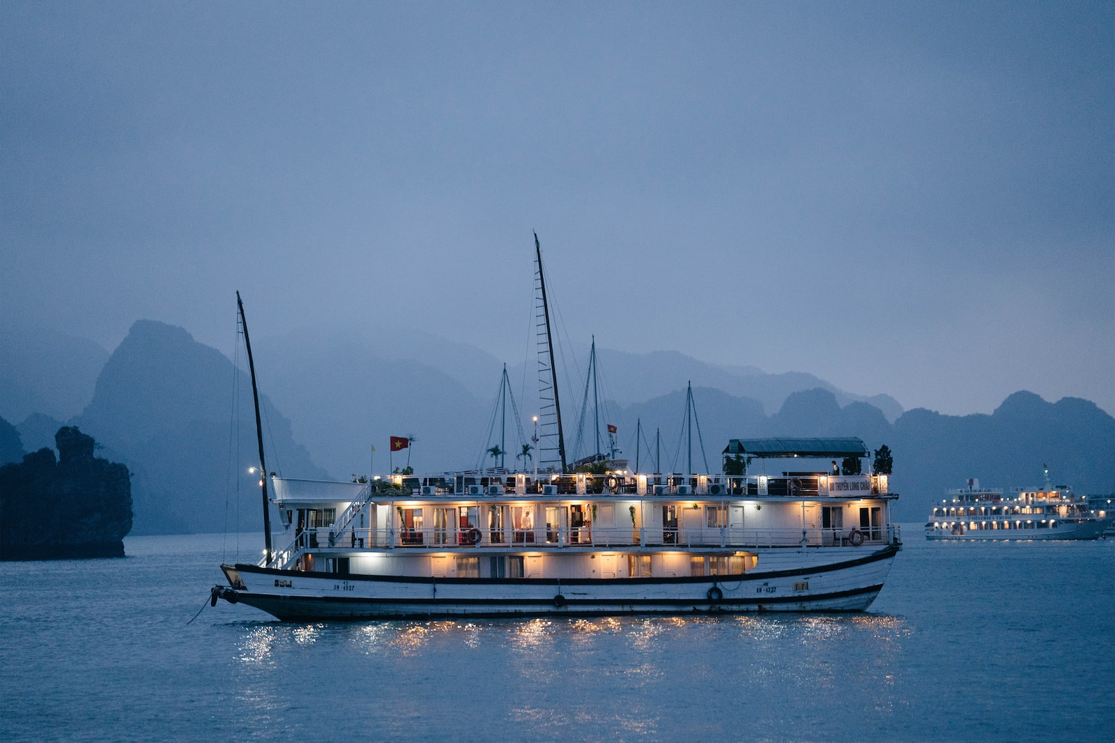 Ha Long Bay boat illuminated at sea