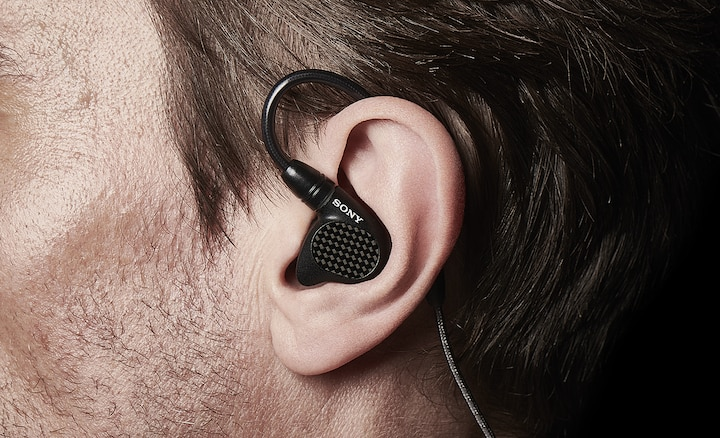 Close-up of the IER-M9's snug fit in someone's ear