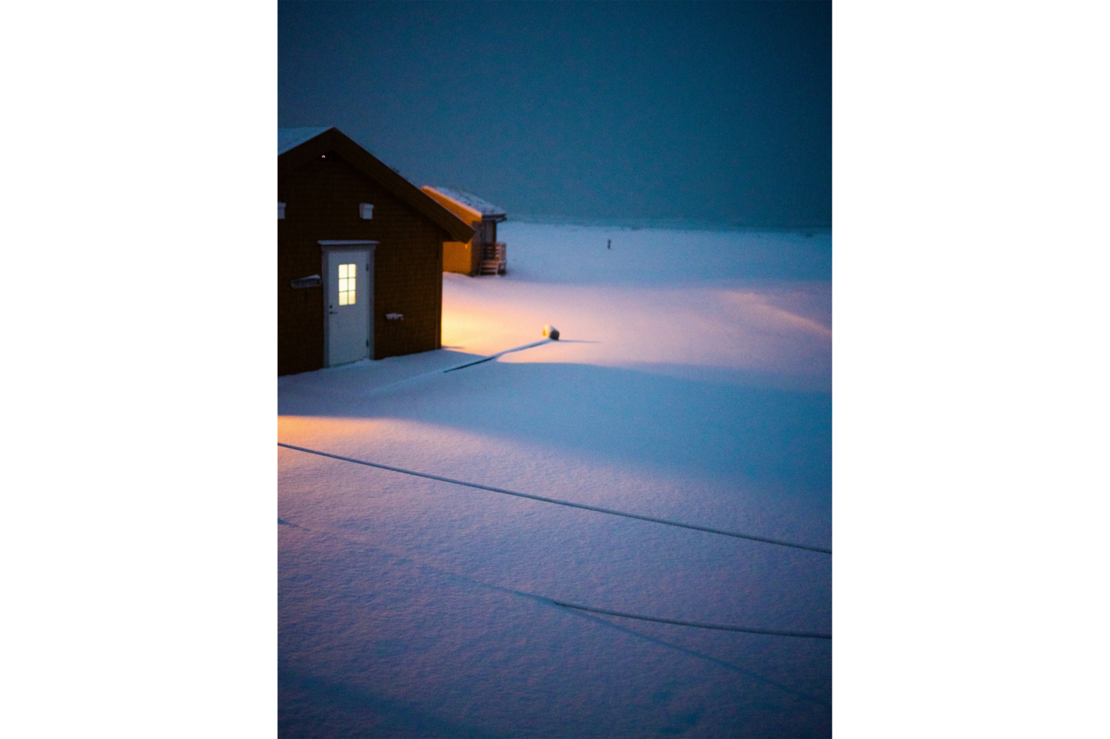 house in snowy field at night alpha 7RIV