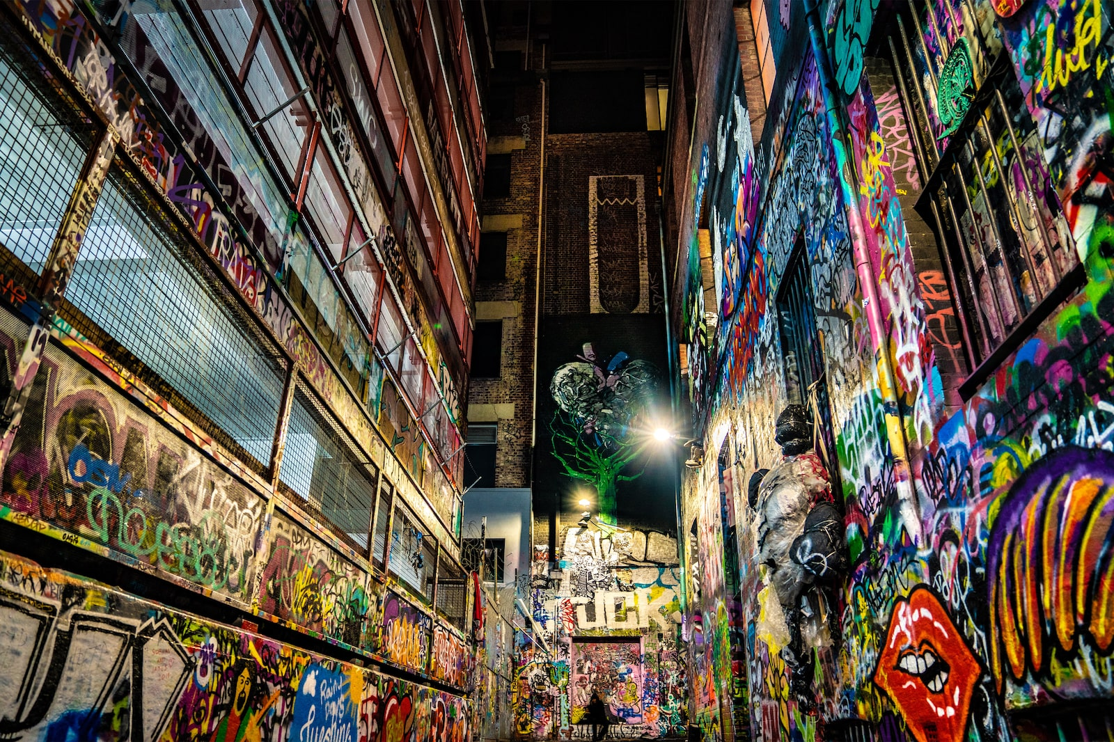 Colorful graffiti lanes facing a brick wall in Hosier Lane