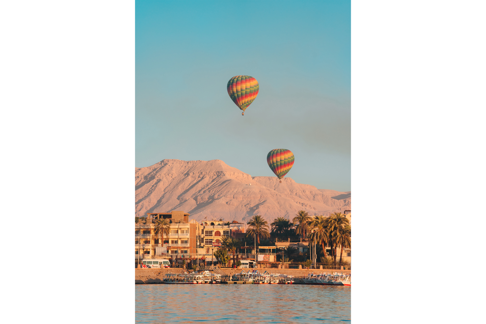 hot air balloon over coastal town alpha 7RIII