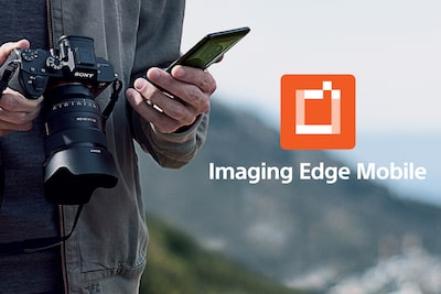 A man holding α1 and smartphone and Imaging Edge Mobile logo