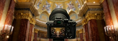 View of the camera from the back, with the out-of-focus interior of a church in the background