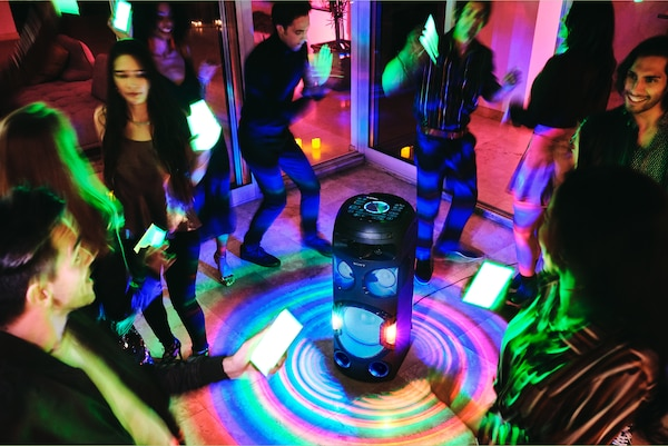 Partygoers using Party Light via Fiestable app on their smartphones