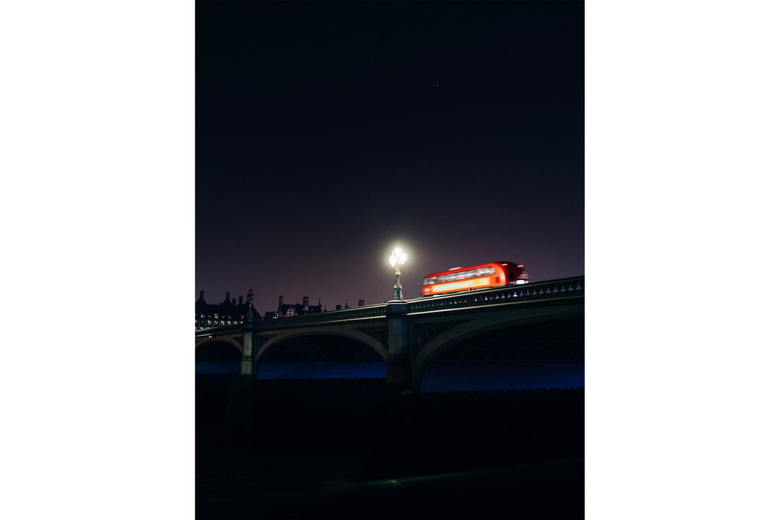 red bus going over bridge alpha 7RIII