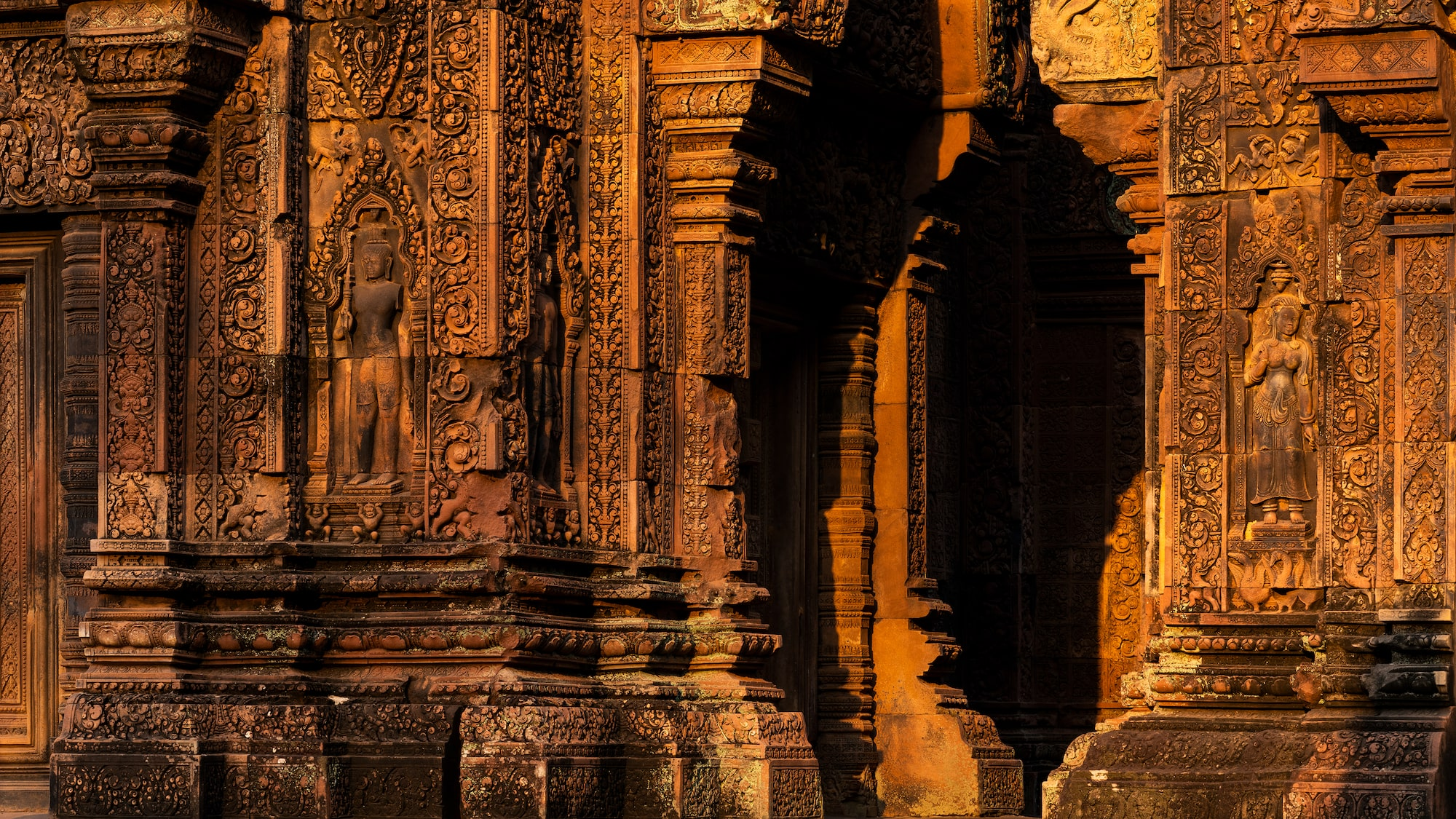 Carvings on door and wall in evening light in Banteay Srei