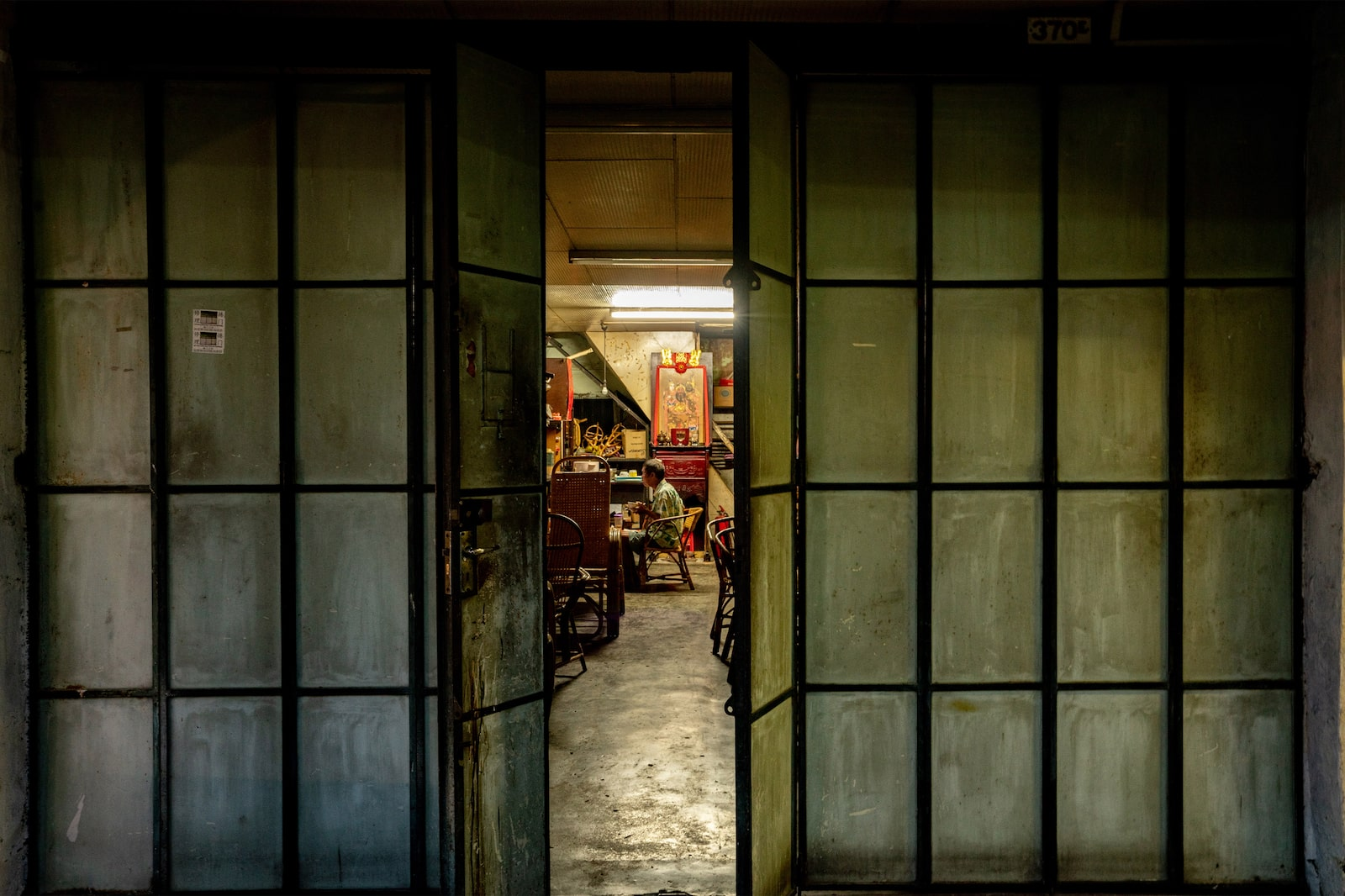 Doors partitioning the interior of an old shophouse