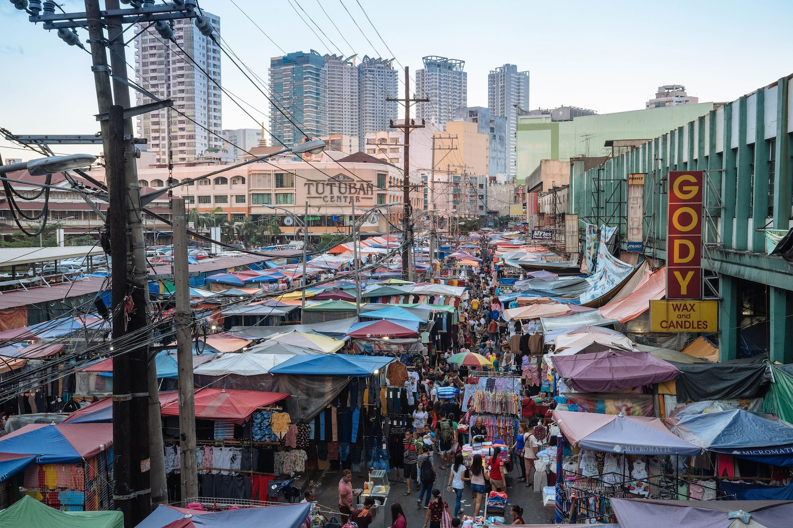 Contrast between skyscrapers and Divisoria Market
