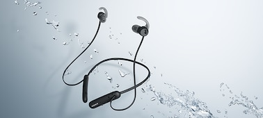 WI-SP510 headphones in black being splashed with water