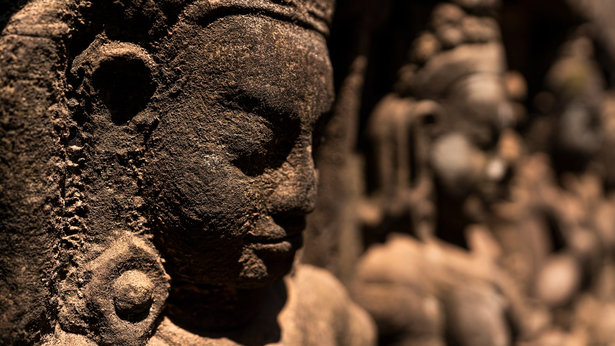 Close-up of rustic statue against bokeh background in Leper King Terrace