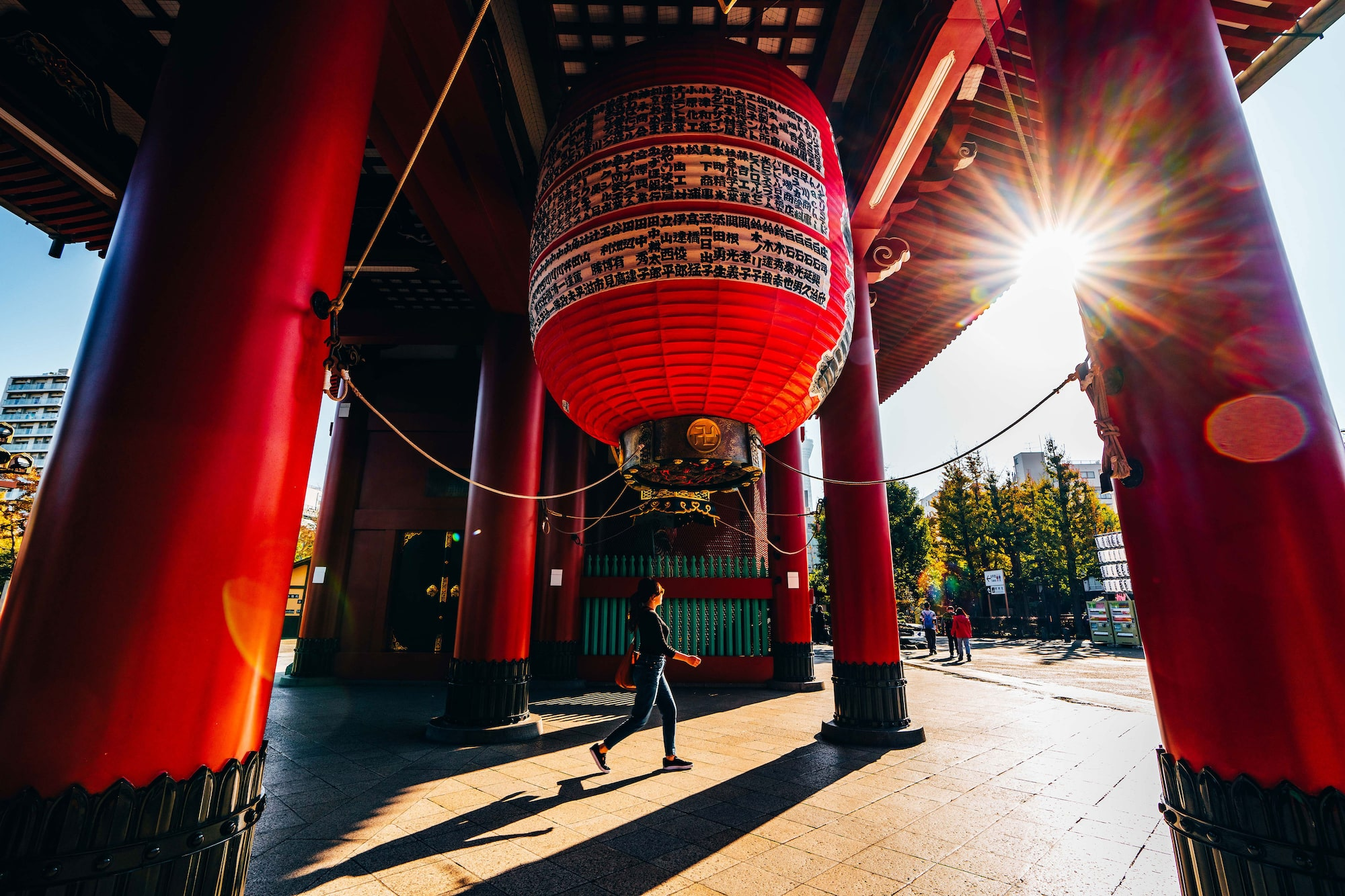 Japan photo of woman walking beneath giant lantern at temple