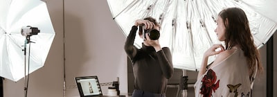 Image of a female photographer and a female model in a photography studio