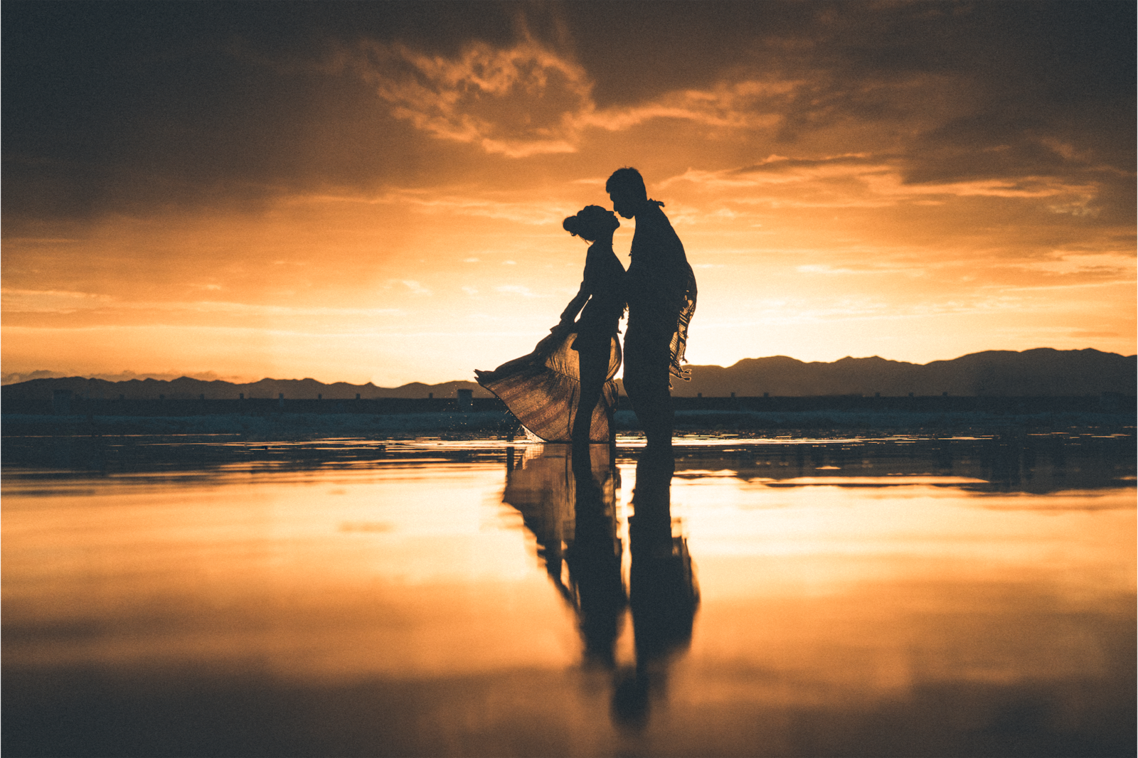 couple standing together at sunset alpha 7RIII