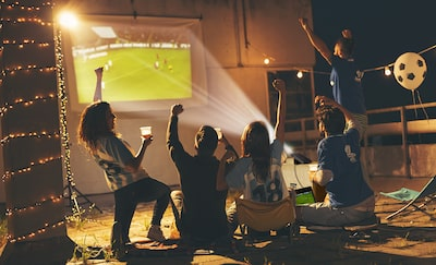 Group watching football with the projector